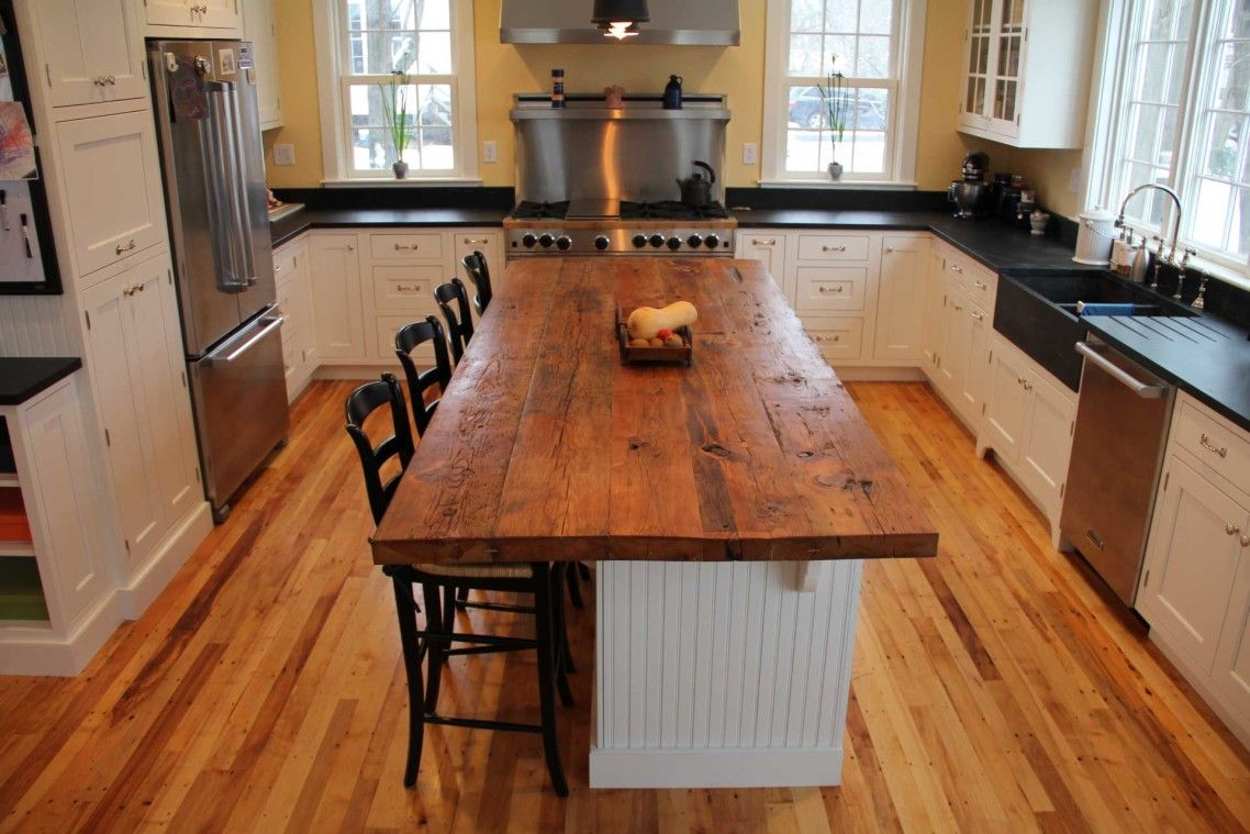 Rectangle brown reclaimed wooden butcher block top over white wooden island on overlay hardwood floor with boos countertops plus butcher block tops for