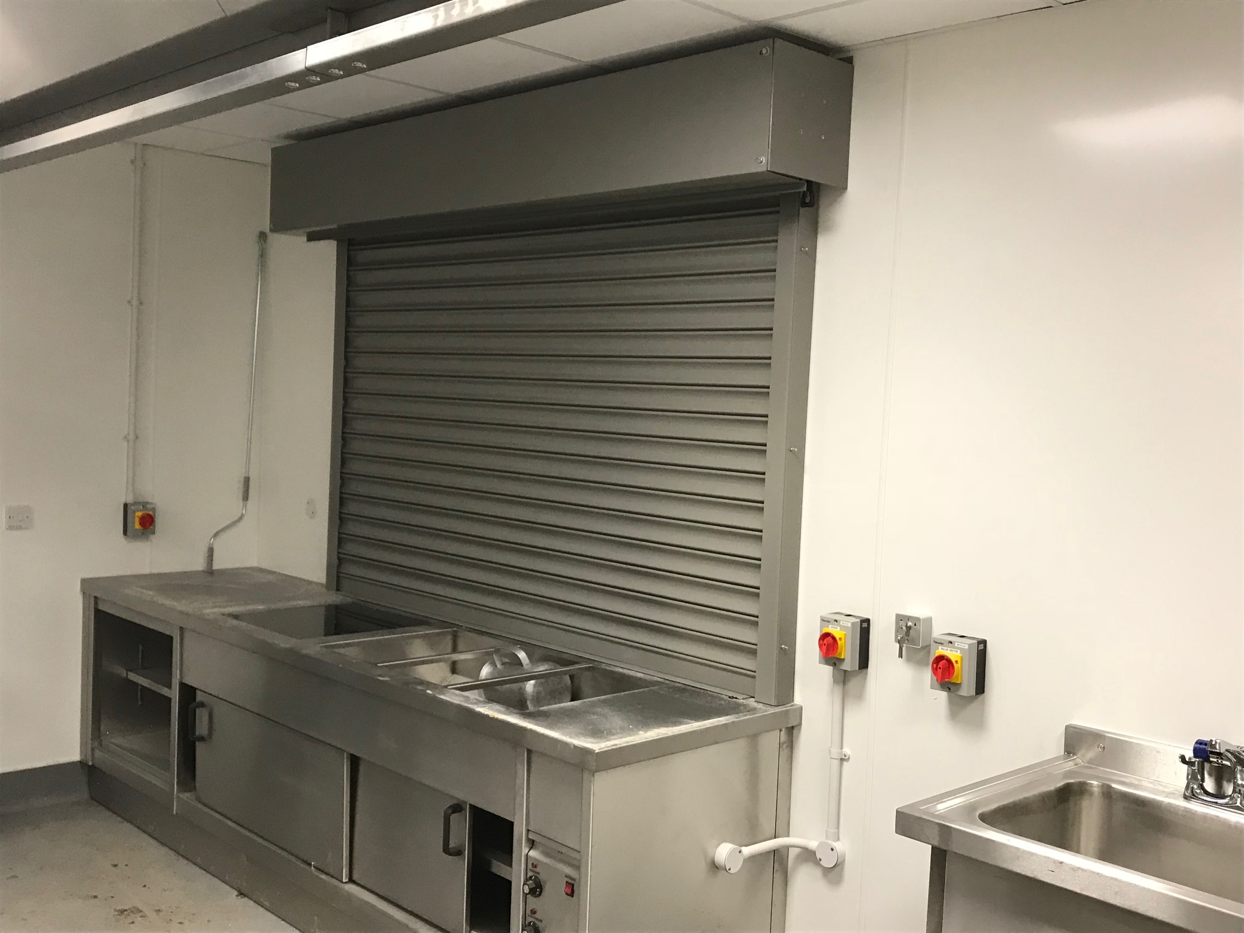 New Fire Rated Roller Shutter Installed In A Kitchen Serving Hatch
