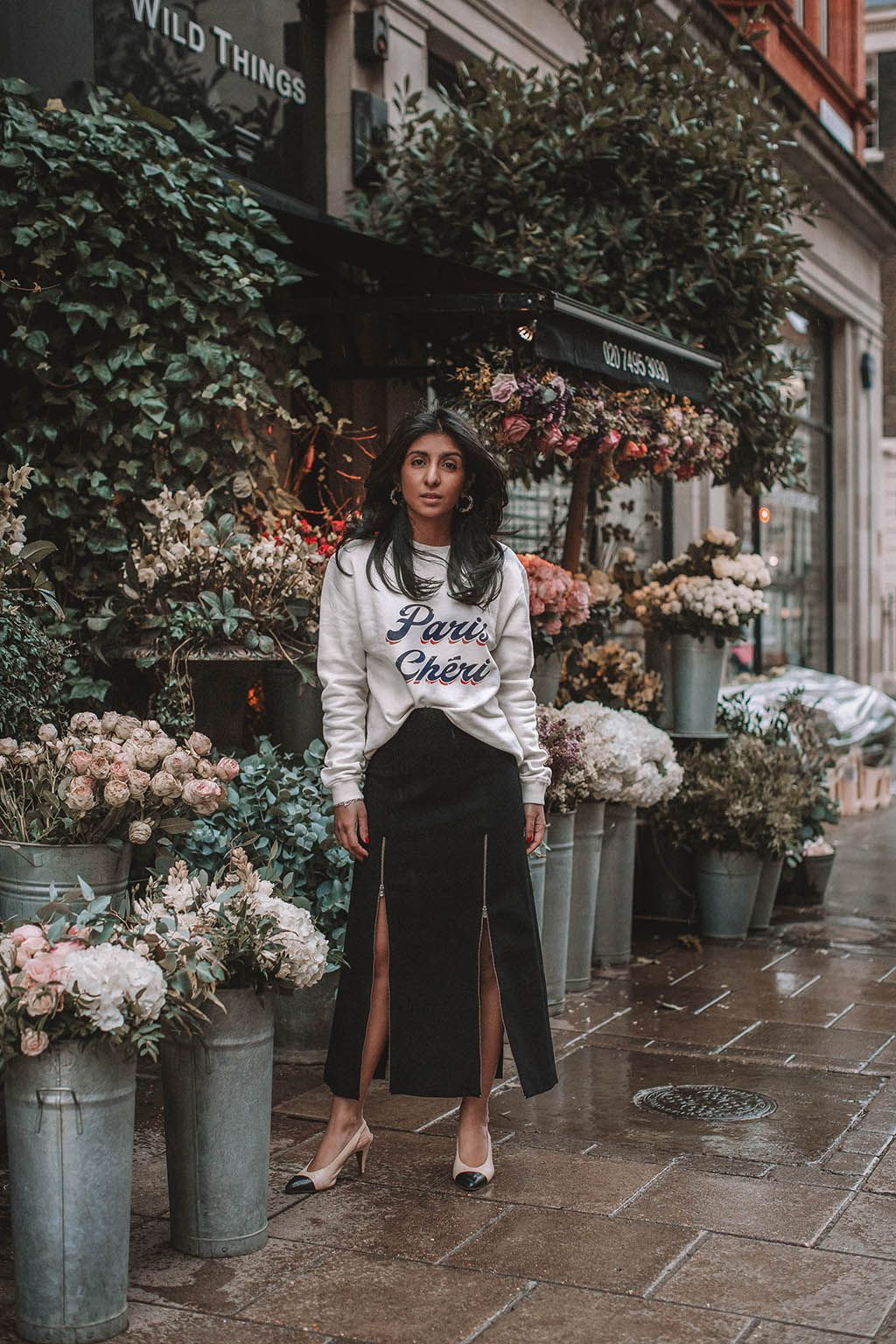49cf9c765 Fashion blogger Shloka Narang of The Silk Sneaker shares a style trick for  how to style a statement sweater for a cozy and cute spring summer outfit  ...