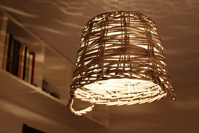 DIY Basket lamp. It gives a nice effect on the wall.