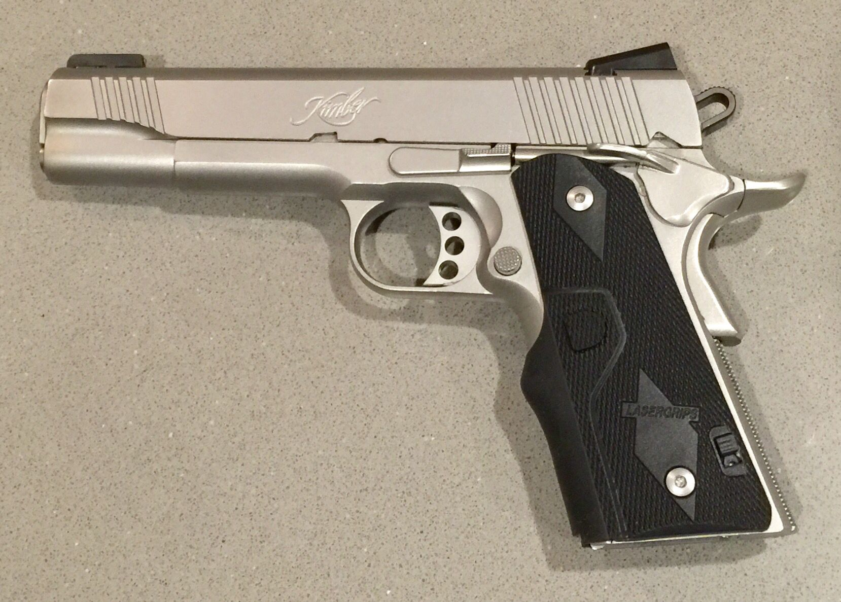 Just added the LG-301 Crimson Trace laser grip on my Kimber 1911
