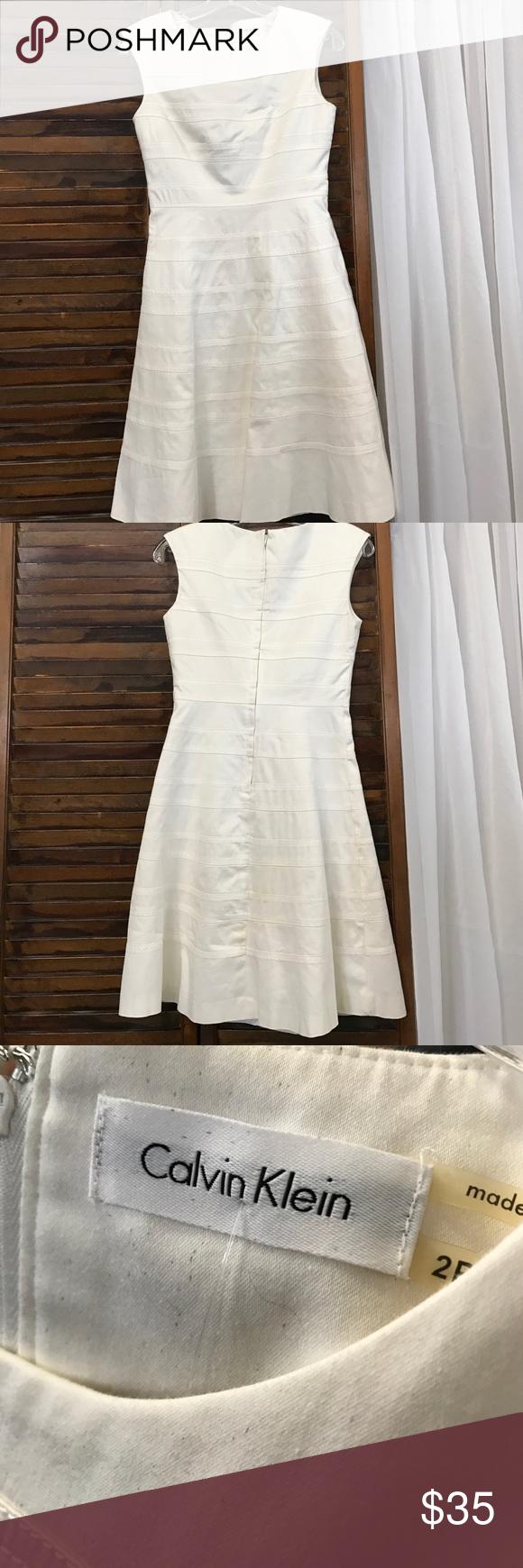 Calvin Klein dress Calvin Klein white dress. Invisible zipper in back. In good condition. Size 2 Calvin Klein Dresses