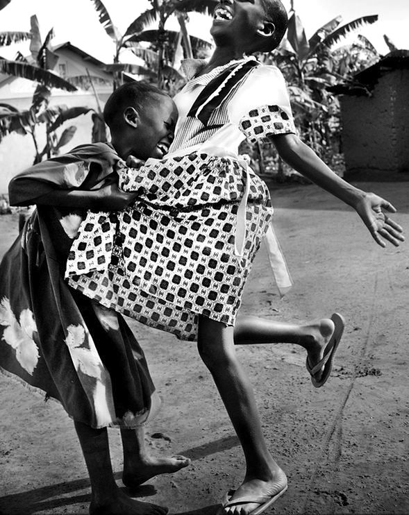 Ugandan girls laughing - national geographic picture of the day