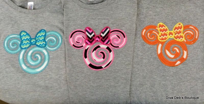 Swirly Mouse head with a bow appliqued on  a short sleeved tshirt children and adult sizes. by Debbiemomofjack on Etsy https://www.etsy.com/listing/221634066/swirly-mouse-head-with-a-bow-appliqued