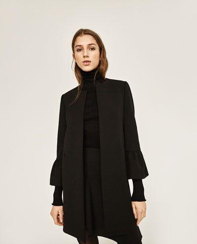 outfit cappotto bianco e nero zara
