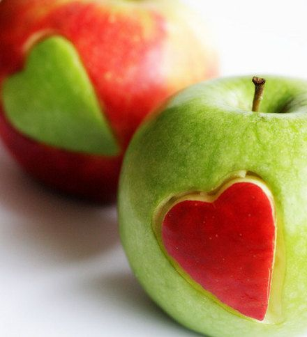 you cut out a heart in different color apples then stick it in the other color apple