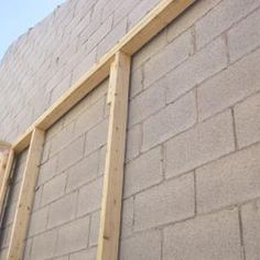 How To Cover A Cinder Block Interior Hunker Cinder Block House Concrete Block Walls Cinder Block Walls