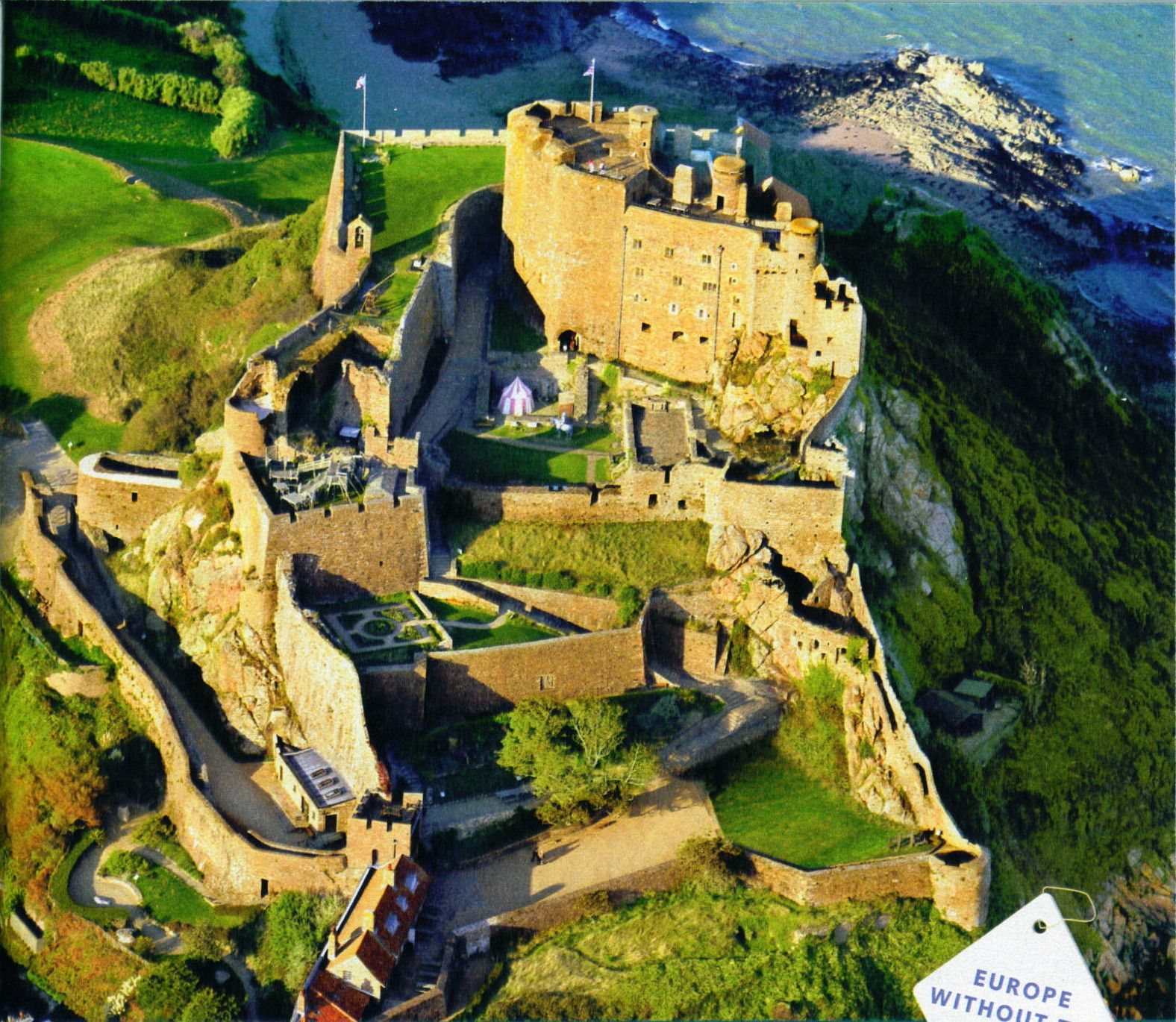 Aerial view of vast, complex Mediaeval castle with lots of criss-crossing ...