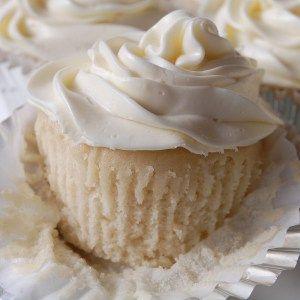 Perfect Vegan Almond Vanilla Cupcakes, fluffiest, softest white cake ever, more at www.dishdashnosh.com