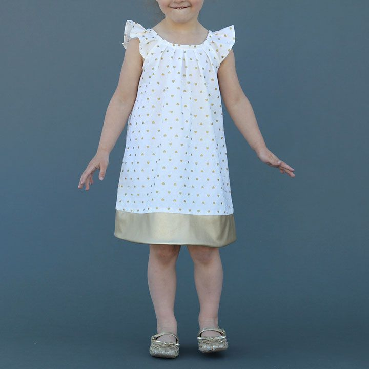 Free printable pattern for a pleated neck, flutter sleeve dress. Little girls size 4T. Great step by step sewing tutorial as well!
