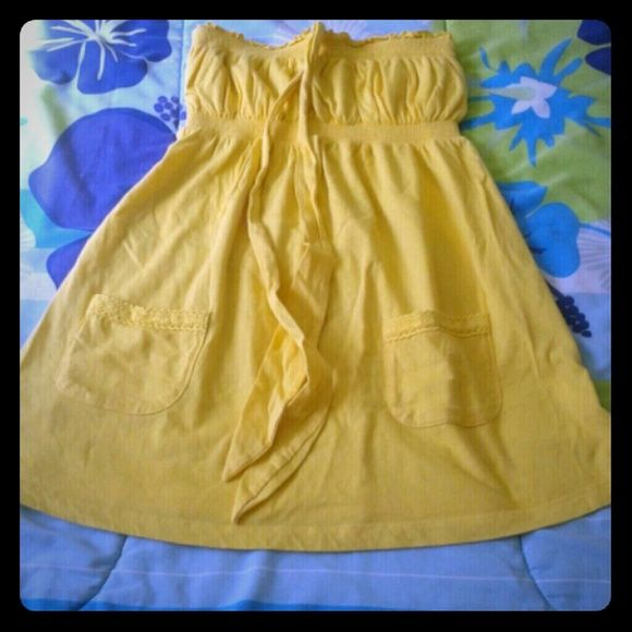 Yellow halter top Final price Pretty halter top with cute pockets. Too small for me. Perfect for summer. Has string for tying at neck but is removable. Only worn  once. SO Tops