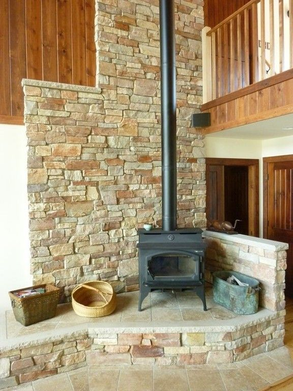 Woodstove Is Beautiful And Functional Elevated On Stone Hearth