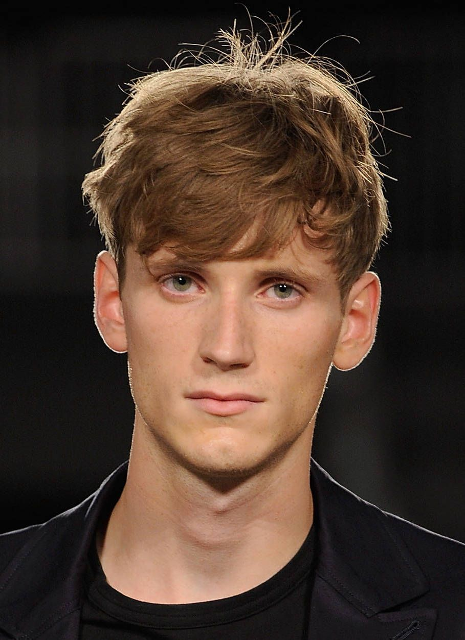 Deliberately messy and tousled mens hairstyles short