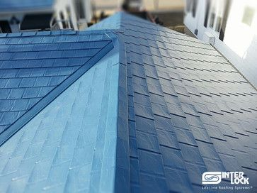 Lifelong Metal Roofing Slate Design Interlock Roofing Ltd Has Created A Unique Slate Styled Product That Has The Lo Metal Roof Slate Roof Roof Solar Panel