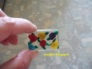 beautiful resin pendant with fabric roses