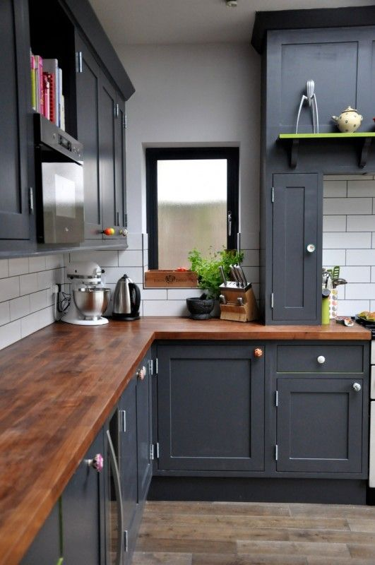 black kitchen cabinets with colorful knobs and wood countertops rh pinterest com kitchen storage cabinet with countertop kitchen base cabinet with countertop