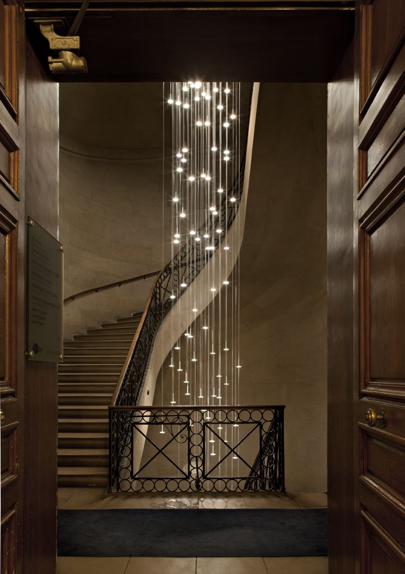 Not Sure Which Is More Spectacular The Stairway Or Lighting Cascading Lights Within A Winding Staircase