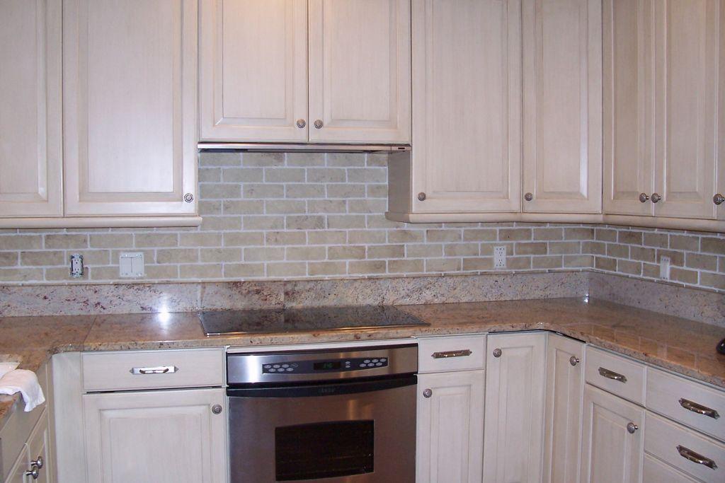 Textured brick backsplash and refinished cabinets for Textured backsplash