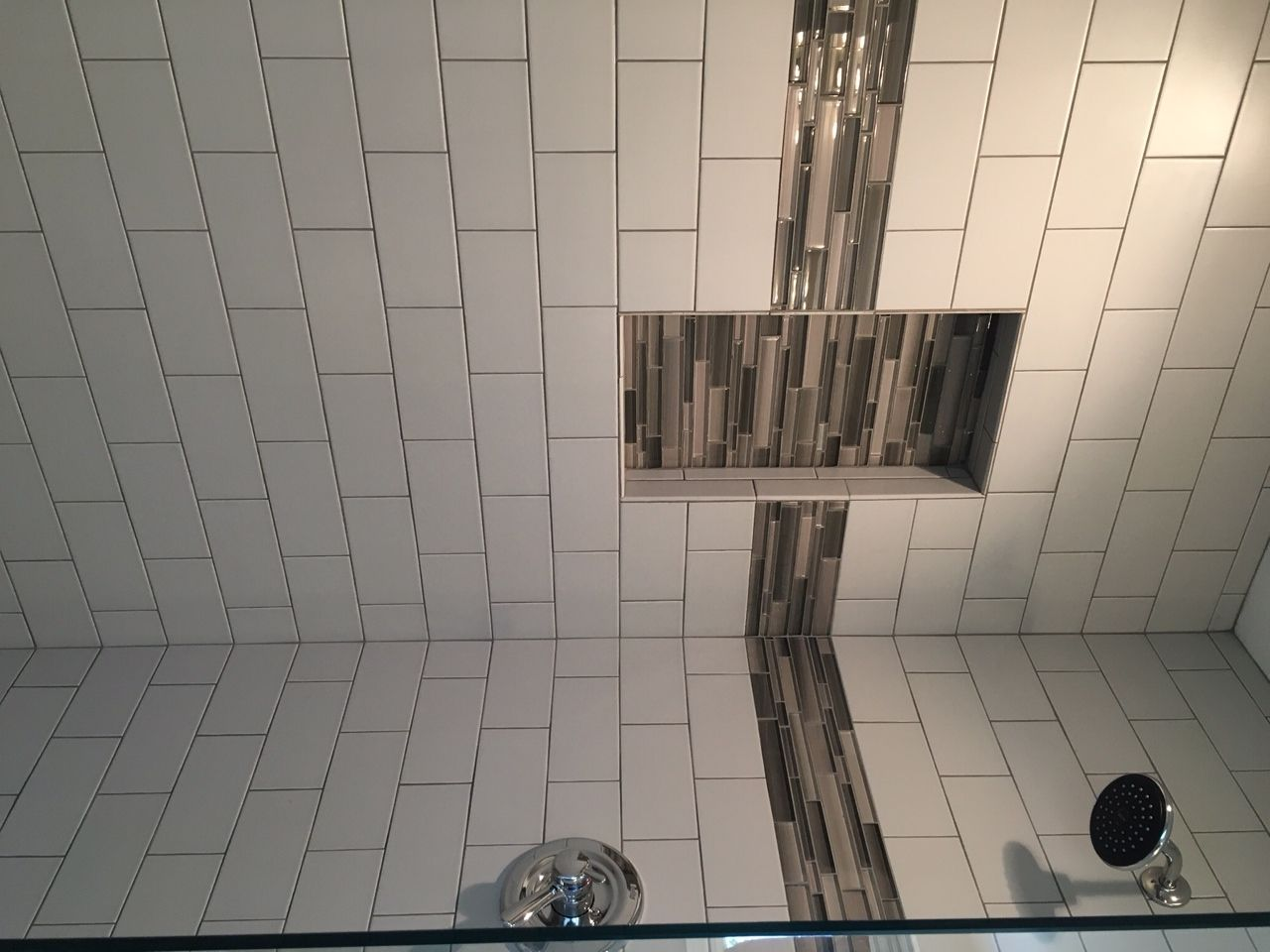 A Subway Tile Shower With Unique Gl Wall Insert Feature Installed By