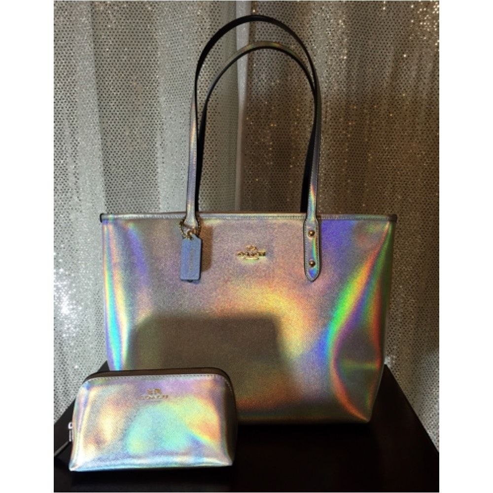 Coach Nwt Hologram Limited Edition City Zip Set Iridescent Tote Bag. Get one of the hottest styles of the season! The Coach Nwt Hologram Limited Edition City Zip Set Iridescent Tote Bag is a top 10 member favorite on Tradesy. Save on yours before they're sold out!