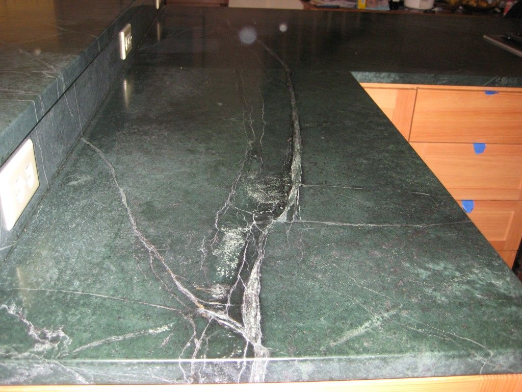Picture Of Green Soapstone Countertops With Raised Bar