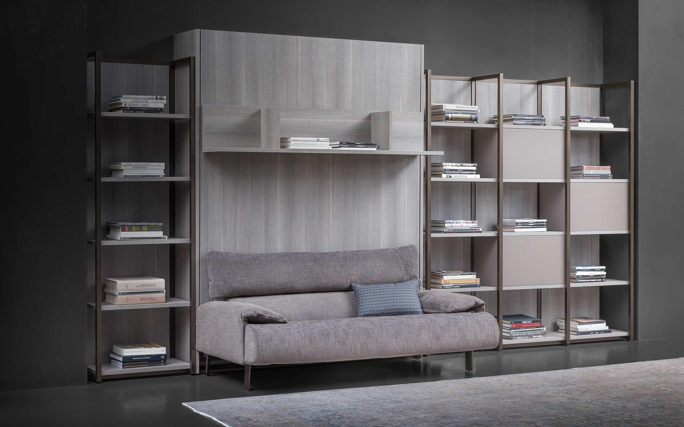 Mobile parete con letto a scomparsa e divano flou london bridge design giulio manzoni sistema for Parete con letto a scomparsa