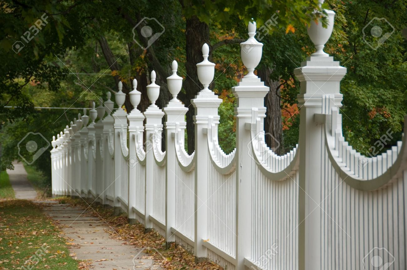 Stock Photo - Old white picket fence in an autumn landscape. | white on home front porch designs, home painting designs, home greenhouse designs, home railing designs, home decorating designs, home septic tank designs, home building designs, home fireplace designs, home facades designs, home gardening designs, home trellis designs, home builder designs, home ponds designs, home arches designs, home backyard decks designs, home flooring designs, home pergola designs, home roof designs, home perimeter wall designs, home front entry designs,