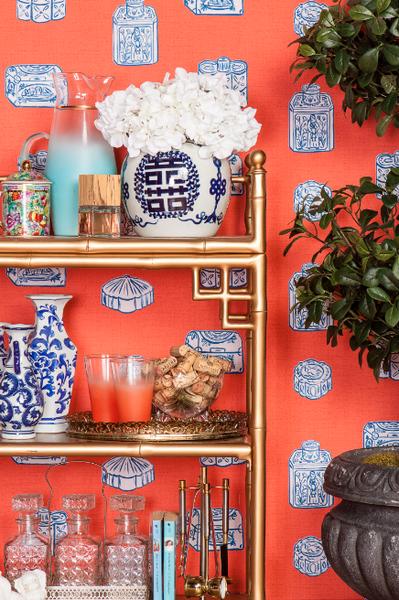 loren console + vintage pastel pitcher set + cut glass decanters + porcelain pekingese dog + ginger jar wallpaper