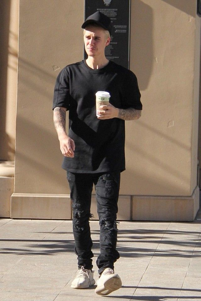 Justin Bieber wearing James Perse Double Face Knit Trucker Hat, Amiri Leather-Inset Distressed Jeans, Adidas Yeezy Boost 350