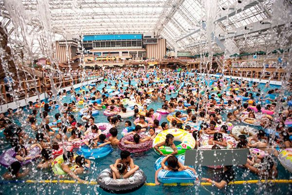 The world's most crowded swimming pool... Photojournalist