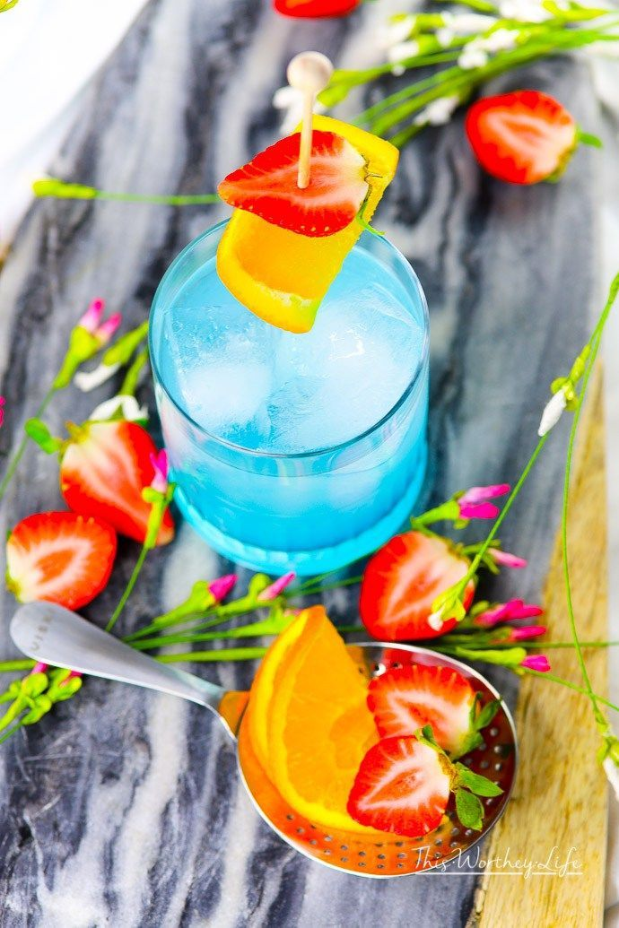 See how we made this beautiful hypnotic drink - perfect for a Black Panther party! This gorgeous #blue #cocktail is perfect #foracrowd,  #parties or even just to enjoy after a long day! Check out our #recipe using #Hypnotiq!