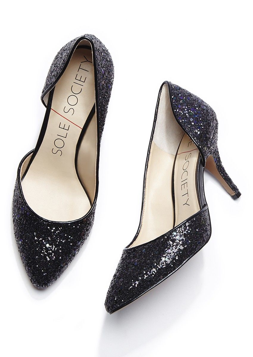 62272cb459476 Glittery black mid heel pumps with a curvy half d