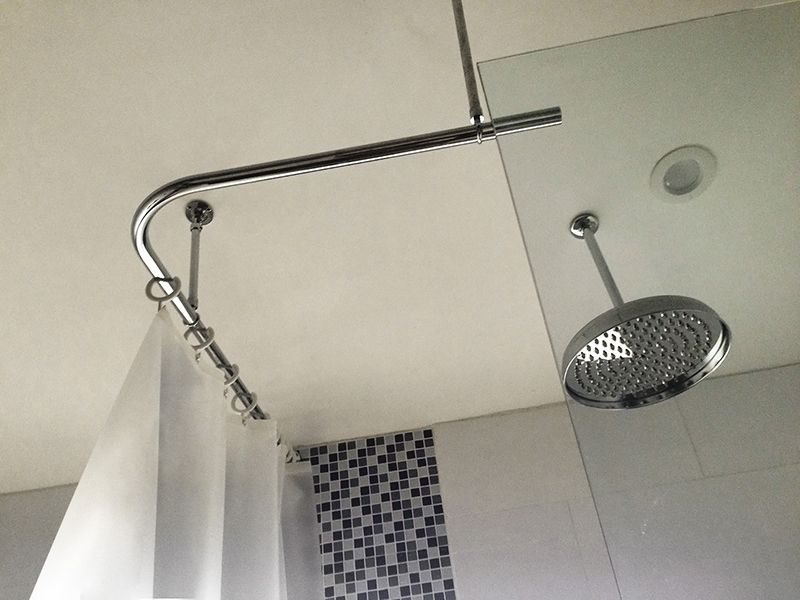 Corner shower curtain rod with a suspended end. Used with white open ...