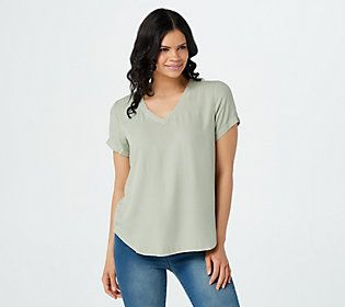 Ask for a tee that'll feel fresh six months from now, and we'll show you this very versatile woven V-neck. From Side Stitch.