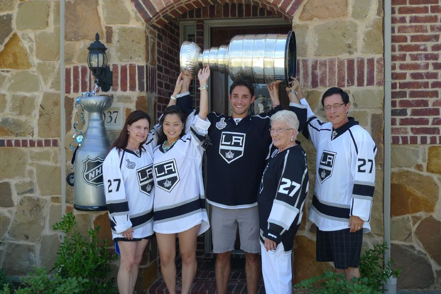 Alec Martinez and his family raise The Stanley Cup in front of his home in Allen, Texas.