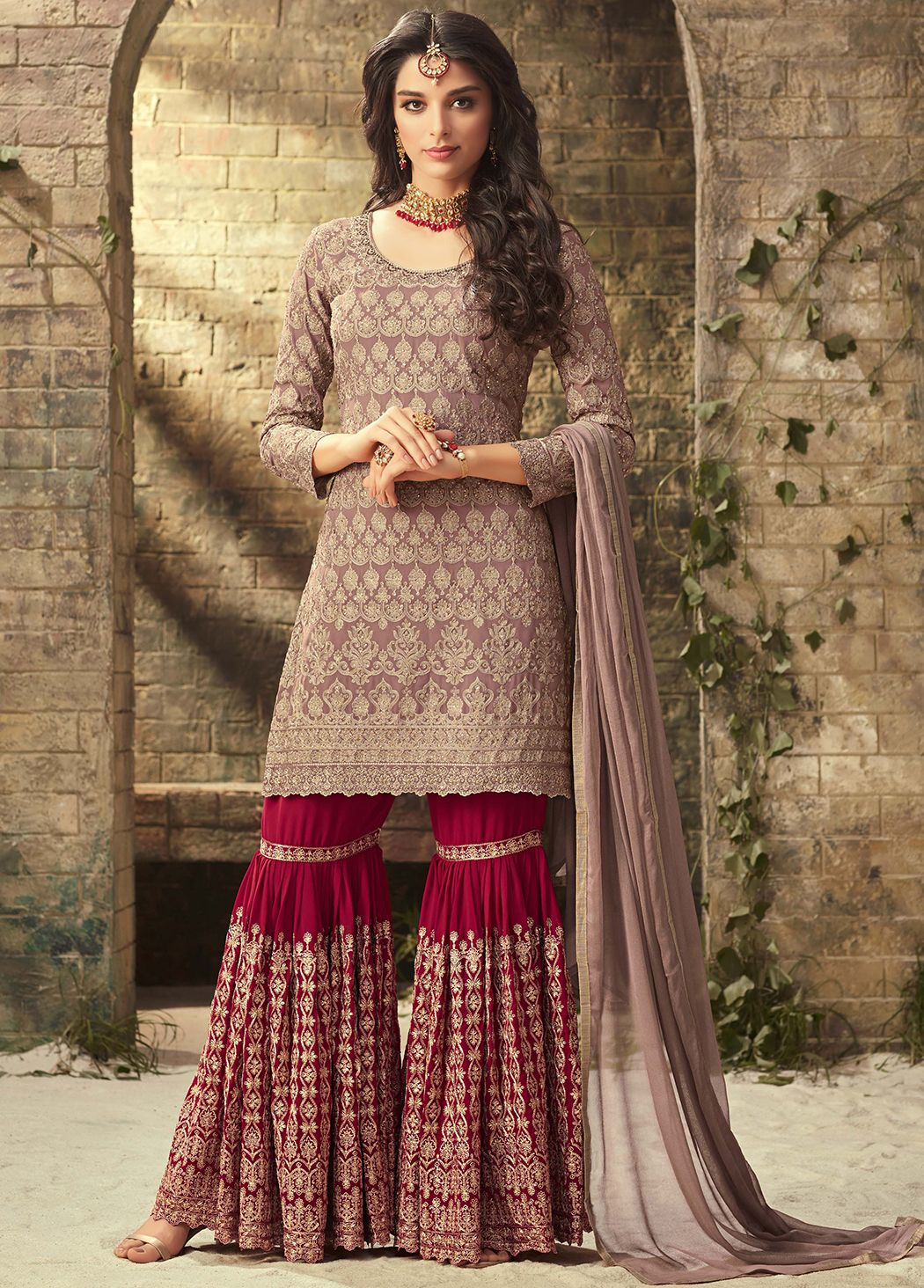 fa52165b4a #Mauve #faux #georgette #sharara #suit enhanced with #crystal worked  #embroidered decorative designs which is spread on entire body.