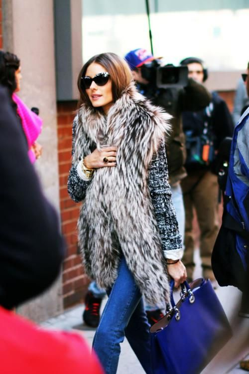 Long fur jacket for Olivia Palermo and blue bag