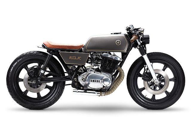 The Yamaha XS500 may not have anywhere near the street credentials of its big brother, the XS650, but if you ride a parallel twin less than 30 years old you owe a debt of gratitude to the younger sibling. It's a potential Tommy Rand, Co-Founder of Relic Motorcycles from Aarhus, Denmark, saw when he found this particular 1977 Yamaha XS500 for sale in Copenhagen. He must have a great creative imagination, because the bike he came to see had been subjected to a terrible rebuild, strange yell...