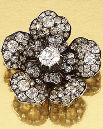 DIAMOND BROOCH, 1890S Designed as a flower head centring on a cushion-shaped diamond, the petals set throughout with rose-, single- and circular-cut diamonds, one stone a later replacement, detachable brooch fitting.