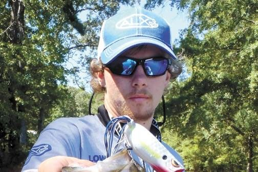 Oconee Bass Moving Shallow With The Shad  0 Ten locations with GPS numbers for October bass on Oconee.  Cody Stahl with an Oconee bass that hit a frog fished through a blowdown at hole No. 10 in Lick Creek.