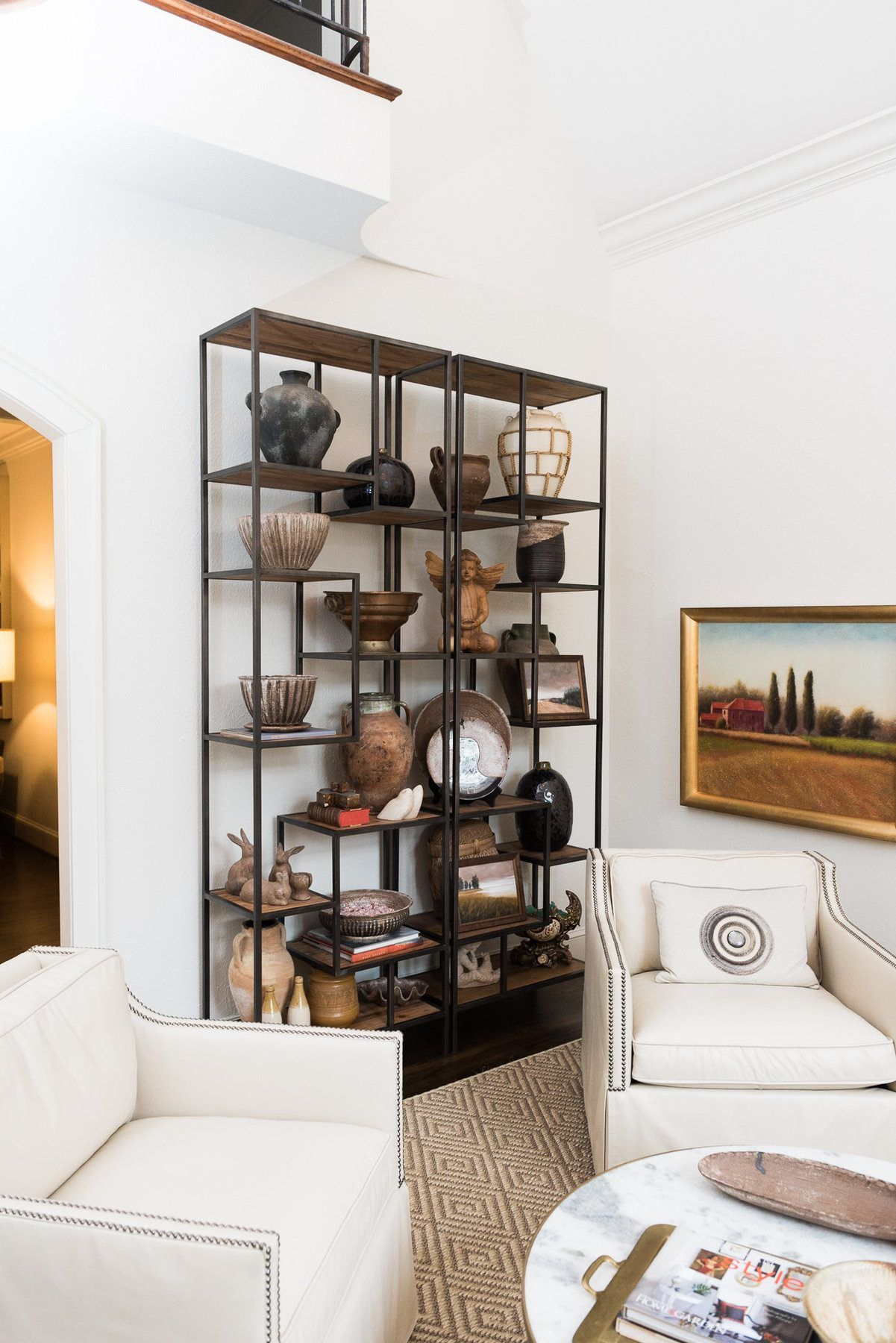We Used Those Etageres To Display Their Mccarty Pottery Collection Because They Really Add Height To The Room Says Sea Pottery Display Interior Design Home