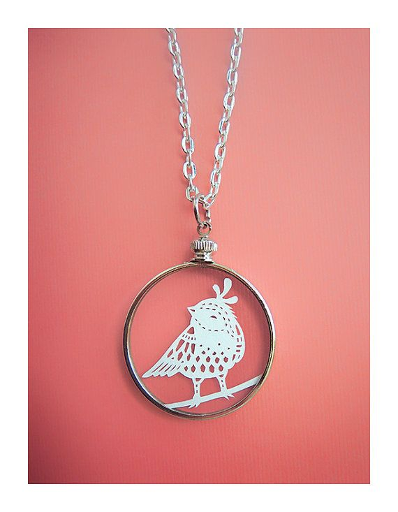 tiny little papercut bird necklace cut by hand with an x acto