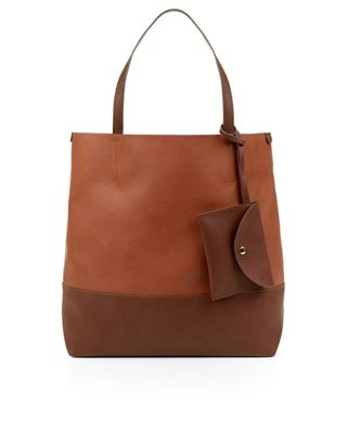 Made from faux leather, this  shopper bag is designed with a contrast base and handles, and is spacious enough for all those everyday essentials. Inside, there's a detachable pouch and a co-ordinating zip-top purse that can be easily detached.