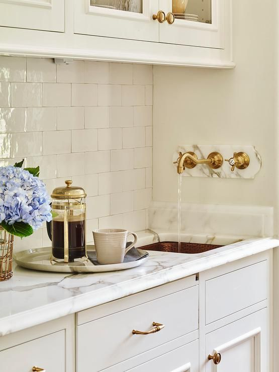 Exquisite Butler S Pantry Features Gl Front Upper Cabinets And White Lower Paired With Marble Countertops A Glazed Tiled