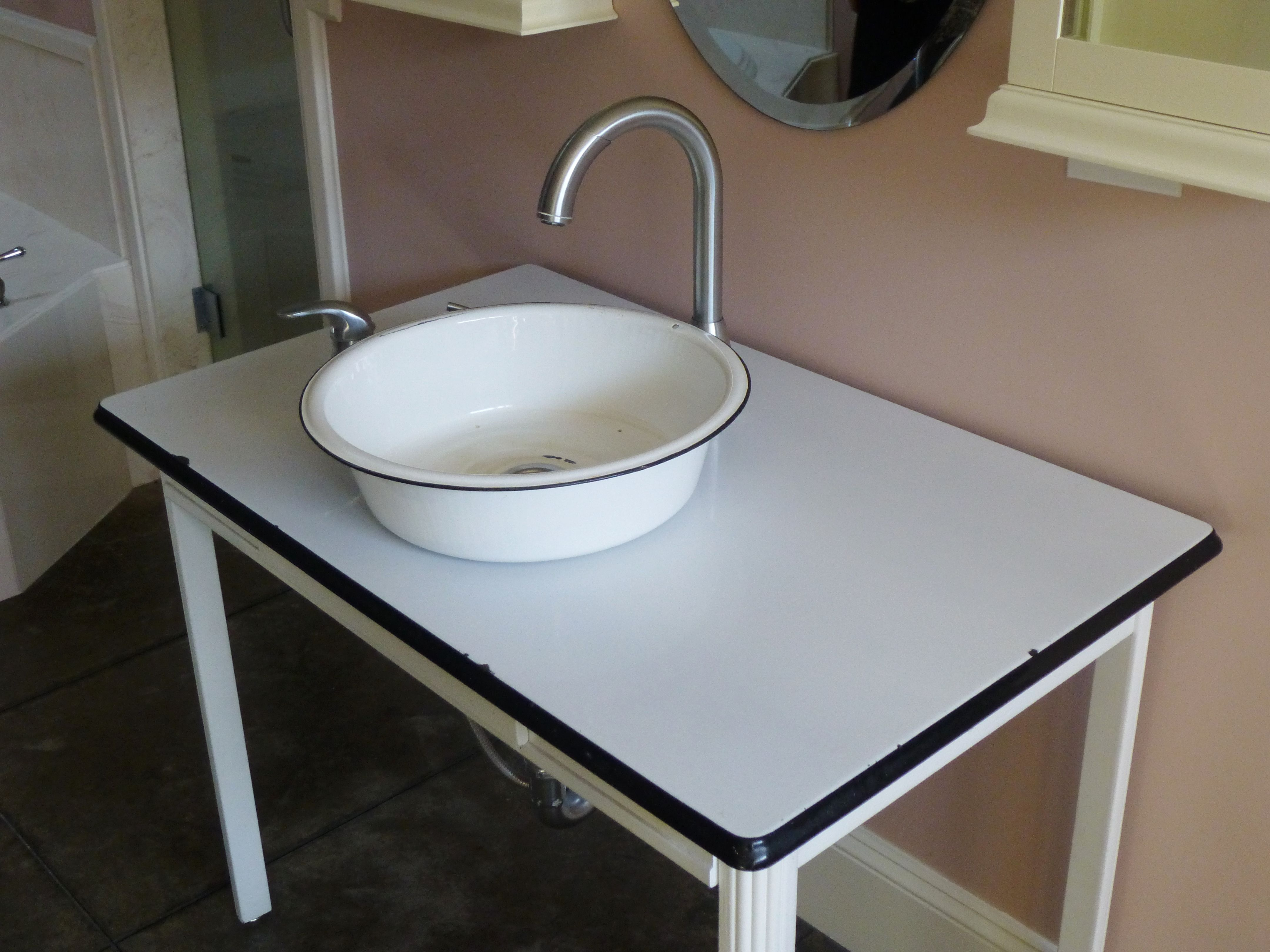 Bathroom Sink In A High End House Made From An Enamel Pan And