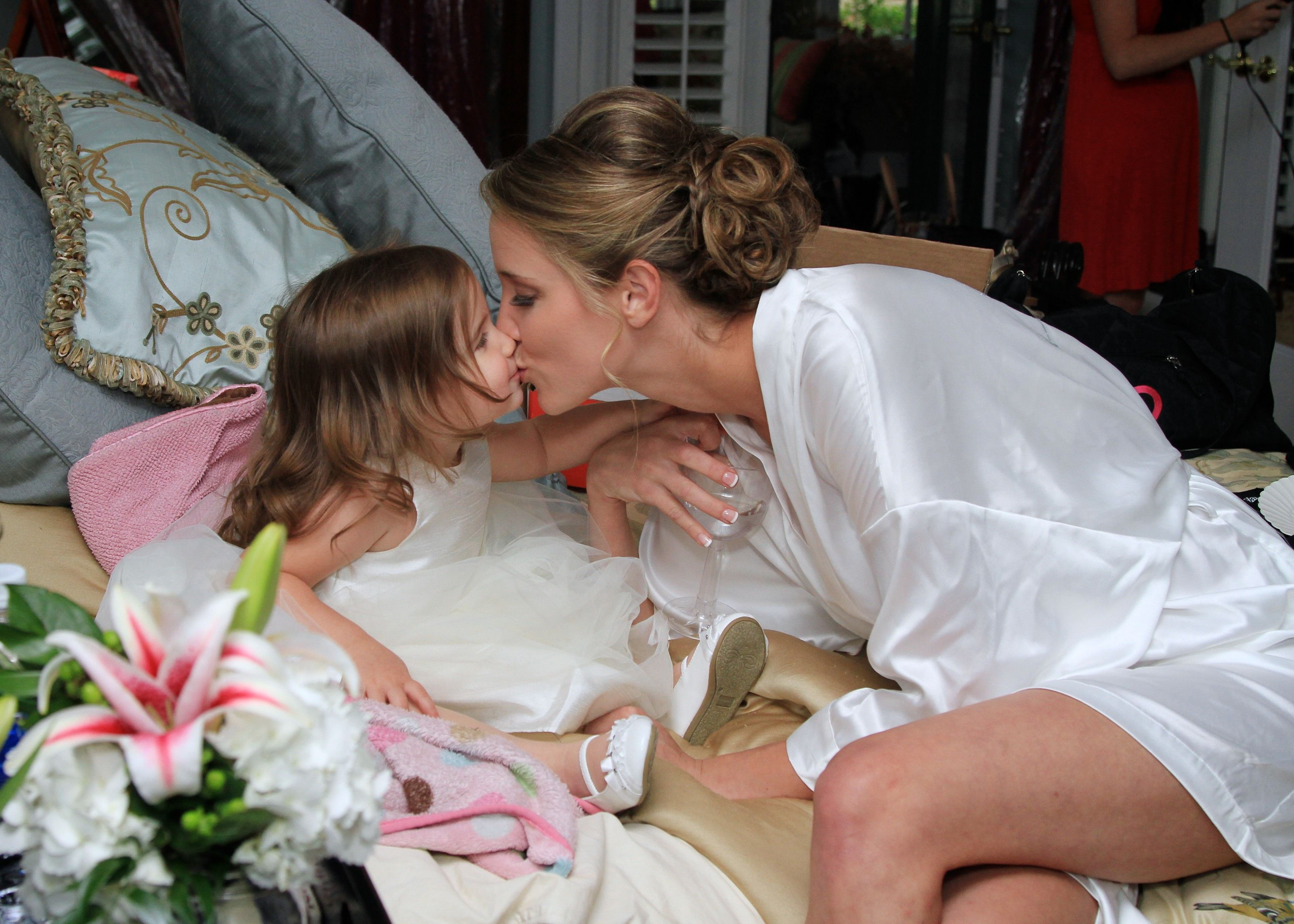 Southern Savvy Events.  Amanda & Aaron | Bride | Flower Girl | Lilies | Kisses | Getting Ready