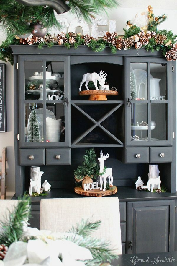 Painted the buffet and hutch {and dining room table} a couple of years ago with Annie Sloan chalk paint in graphite and I love the look of the black against the white plates and other decorative items.  Beautiful Christmas home tour! with lots of simple Christmas decorating ideas.