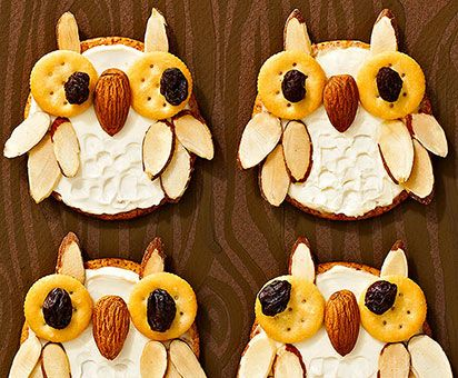 Owl Snack-Topped with cream cheese and almonds.For the eyes pull apart a Ritz Bits sandwich cookie and used half for each eye.  Attach raisin pupils with a dab of cream cheese. Finish by pressing on an almond beak and almond-slice feathers.