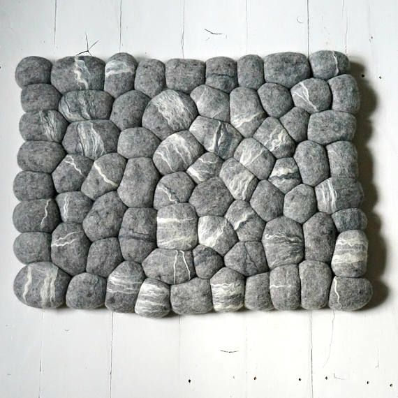 This natural wool felted rug is very soft and a great addition to any room in your house. Especially in bathroom. Incredibly soft and beautiful, unique felted carpet is made from natural wool handmade artistic stones. This rug attract eye and gives wonderful feeling to the foots when you step on it.  As stones in mother nature are all unique and where is no another one the same so it is the same with wool carpet stones. Your carpet is one of the kind!  A felt stone carpet consists of stones…