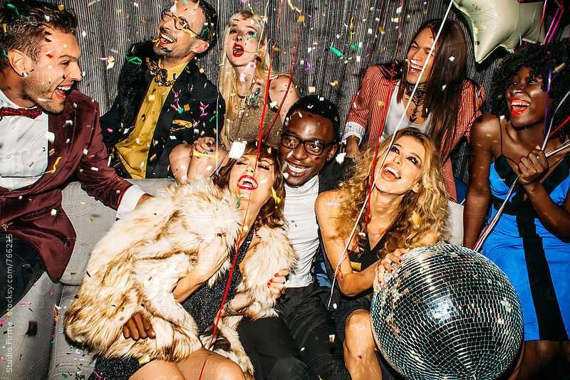 Group of happy people partying together having a great